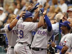 Adrian Beltre (29) is congratulated by his teammates after hitting his second home run of the game.