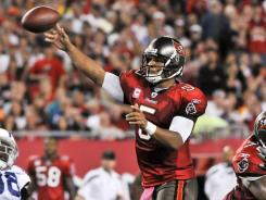 Josh Freeman threw one touchdown and ran for another to help the Buccaneers win their third consecutive game.