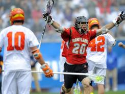 Scott LaRue and Maryland were called for 10 stall warnings in their 2011 NCAA quarterfinal win against Syracuse. Experimental rules being tested in scrimmages this weekend are aimed at speeding up the game.