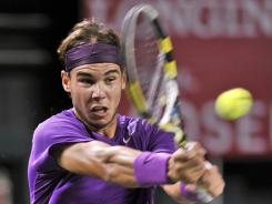 Rafael Nadal of Spain eyes a backhand during his victory against Go Soeda of Japan on Tuesday in the Japan Open.