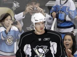 All eyes, and lenses, on him:  Fans hope doctors clear Sidney Crosby soon.