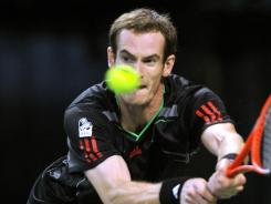 Andy Murray of Britain eyes a backhand during his victory Wednesday against Marcos Baghdatis of Cyprus.