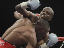 Timothy Bradley unified  the WBC and WBO 140-pound belts by defeating Devon Alexander (foreground)  at the Silverdome in Pontiac, Mich., in January.
