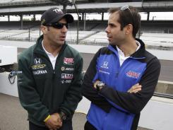 Tony Kanaan, left, estimates he and workout partner Vitor Meira, right, have logged more than 7,000 miles on their bikes and run more than 3,000 miles in preparation for Saturday's Ironman triathlon.