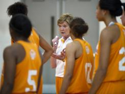 Tennessee women's basketball coach Pat Summitt talks with her team during the squad's first practice of the season on Wednesday.