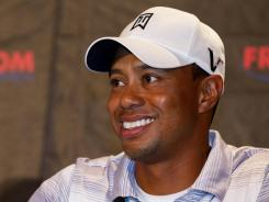 Tiger Woods flashes a smile during his news conference Wednesday at the Frys.com Open.