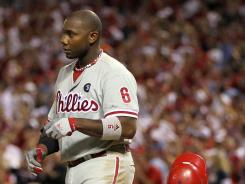 Slugger Ryan Howard drops his helmet after striking out in the eighth inning of Game 4, won by the Cardinals 5-3. Howard is 2-for-15 in the series, with six RBI and six strikeouts.