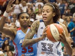 Angel McCoughtry, left, set a Finals record with 38 points in Game 2 and outplayed Seimone Augustus, who scored 36 in the win for the Lynx.