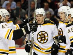 Tyler Seguin, center, and company will aim to defend the Bruins' Stanley Cup title this season.