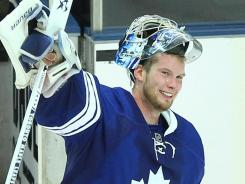 Maple Leafs goalie James Reimer waves to fans after posting a 2-0 shutout against the Canadiens.