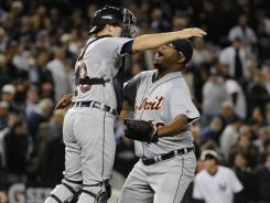 Alex Avila, left, and Jose Valverde celebrate after closed out the Tigers' Game 5 win. Valverde is perfect in 51 save chances this season.