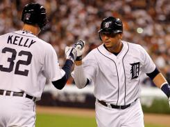Victor Martinez, right, celebrates with Don Kelly after hitting a solo home run in Game 4.