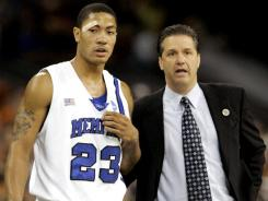 In this March 30, 2008, file photo, Memphis coach John Calipari talks with Memphis guard Derrick Rose (23) in the first half of the NCAA South Regional basketball final, in Houston. Rose, who led Memphis to the 2008 national title game, appears to be at the center of an NCAA investigation of major violations during that season.