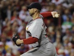 Chris Carpenter sent the Phillies and their MLB-high 102 wins home with a three-hit shutout.