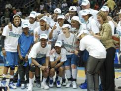 The Minnesota Lynx celebrate the first WNBA championship in franchise history.