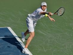 Mardy Fish of the USA chases down a backhard during his victory Friday against Bernard Tomic of Australia.