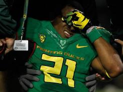 Oregon running back LaMichael James is tended to by doctors after injuring his arm against California.