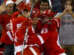 Todd Bertuzzi, center, celebrates with teammates after scoring the Red Wings' first goal of the season.