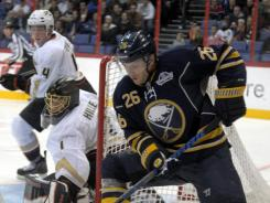 Sabres forward Thomas Vanek (26), controlling the puck in front of Ducks defender Cam Fowler, left, and goalkeeper Jonas Hiller, had two goals and an assist to lead Buffalo to a 4-1 win.