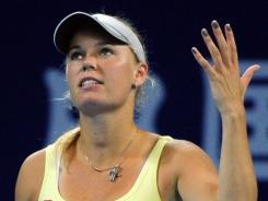 Caroline Wozniacki of Denmark shows her frustration during her loss Friday Flavia Pennetta of Italy.