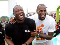 Dwyane Wade, left, and LeBron James, shown here at Nickelodeon's Worldwide Day of Play Sept. 24 in Washington, will headline an unofficial NBA exhibition game Saturday at Florida International University.