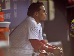 Catcher Carlos Ruiz looks on from the dugout  after the Phillies lost Game 5 of the NLDS to the Cardinals 1-0. Despite all the great pitching, the Phillies fell short of expectations.