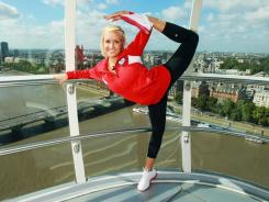 Gymnast Nastia Liukin, seen here posing in the London Eye during a September tour, said she will try and make Team USA's 2012 Olympic team.