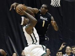 Amar'e Stoudemire (1) and LeBron James (6) were among nine NBA All-Stars who played in Saturday's charity game at Florida International University.