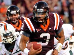 Virginia Tech quarterback Logan Thomas (3) runs ahead of Miami's Sean Spence (31) for the game-winning touchdown late in the fourth quarter.
