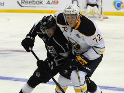 The Kings' Brad Richardson and the Sabres' Luke Adam, right,  battle for the puck during a game Saturday in Berlin. Adam scored two goals in the Sabres' 4-1 win.