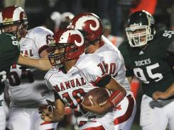 Running back Dishan Romine was one of the few bright spots for Manual, which was routed by No. 4 Trinity 58-7.