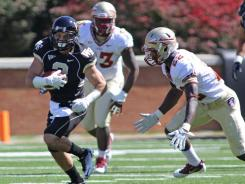 Wake Forest wide receiver Michael Campanaro is pursued by Florida State linebacker Telvin Smith during the first quarter.