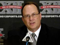 This July 27, 2010, file photo shows Big 12 commissioner Dan Beebe addressing the media during a news conference at the Big 12 Football Media Day, in Irving, Texas.