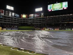 A view of the field during a rain delay in the fifth inning of Game 1.