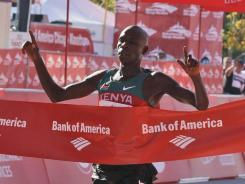Kenyan Moses Mosop crosses the finish line to win the Chicago Marathon on Sunday.