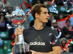 Ribbons fall on winner Andy Murray of Britain, who defeated Rafael Nadal of Spain in the Japan Open final.