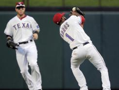 With a lot of white appearing above the webbing, Rangers shortstop Elvis Andrus hauls in a pop fly to end the ninth
