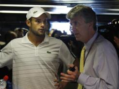 Andy Roddick plays mediator and agitator at the U.S. Open, here discussing scheduling issues with tournament referee Brian Earley.