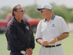 Oakland Raiders owner Al Davis, left, and Dallas Cowboys owner Jerry Jones,  talk in 1997.