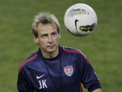 "U.S. head coach Jurgen Klinsmann juggles a ball during Monday's open practice at Red Bull Arena. ""[Klinsmann] believes, and we're beginning to believe,"" U.S. goalkeeper Tim Howard said."