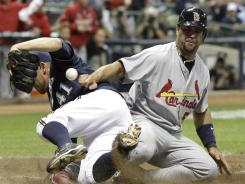 Cardinals star Albert Pujols slides safely past Brewers pitcher Marco Estrada