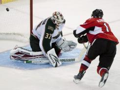 In front of the home crowd, Daniel Alfredsson's goal in the shootout lifted the Senators past the Wild.