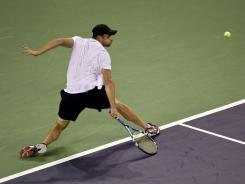Andy Roddick of the USA  slices a backhand during his victory Tuesday against Grigor Dimitrov of Bulgaria.