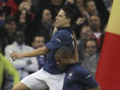 France's  Samir Nasri (left) celebrates with his teammate Loic Remy  after he scored a penalty during a Euro 2012 Group D qualifying soccer match against Bosnia-Herzegovina at Stade de France stadium in Saint Denis on Tuesday.