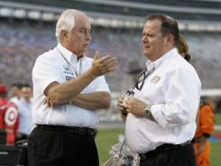 Team owner Roger Penske, left, talks with team owner Chip Ganassi, before a race at Texas Motor Speedway in 2009.