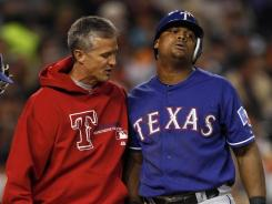 Rangers third baseman Adrian Beltre, right, reacts Tuesday after being hit by a foul ball during the fourth inning.