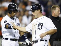 Andy Dirks, right, is greeted by Tigers teammate Ramon Santiago after Dirks scored one of Detroit's five runs in Tuesday's playoff win vs. the Rangers.