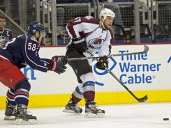 Avalanche center Ryan O'Reilly (37) fires a pass away from the pressure of Blue Jackets defenseman David Savard during Colorado's 3-2 victory over Columbus.