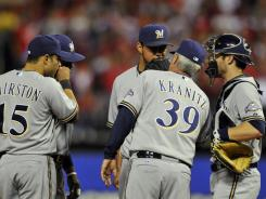 Brewers starter Yovani Gallardo, middle, talks with pitching coach Rick Kranitz during the Cardinals' four-run first inning.