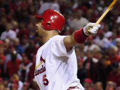 Albert Pujols hits a RBI double against the Milwaukee Brewers on Wednesday.  Pujols and the St. Louis Cardinals won Game 3 of the NLCS, taking a 2-1 advantage.